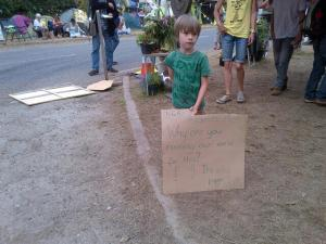 boy with anti fracking banner Balcombe